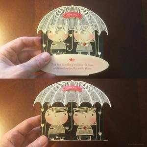 couple-with-umbrella-4.save-for-web.533kb-optimized.square.card.jpg
